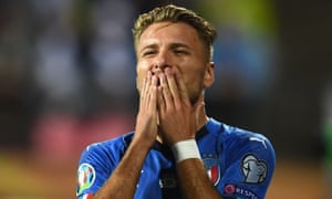 Ciro Immobile of Italy celebrates after scoring the opening goal.