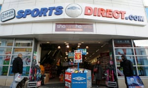 Shoppers wait outside a branch of Sports Direct