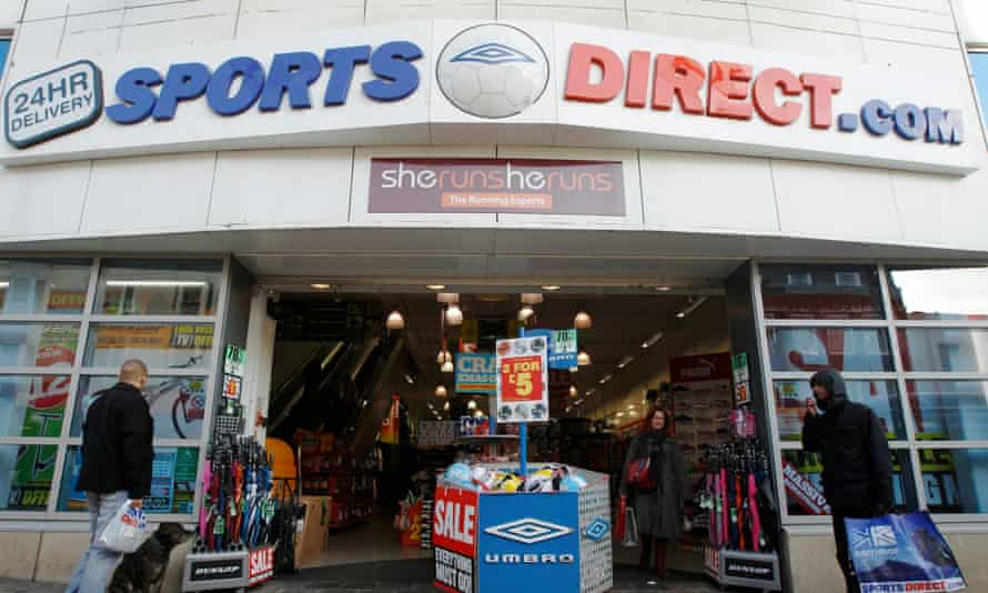 Shoppers waiting outside a branch of Sports Direct in Brighton
