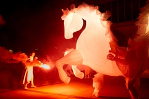 Compagnie des Quidams perform FierS à Cheval, a parade of illuminated white horses accompanied by symphonic music.