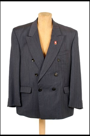Snappy Suit - with a camera concealed in a button.