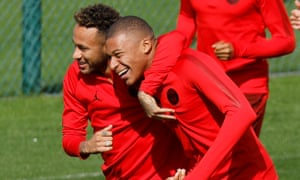 Neymar, left, and Kylian Mbappé share a lighthearted moment during training before the Liverpool game.