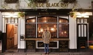 Adam, the landlord outside his pub, Ye Olde Black Boy.
