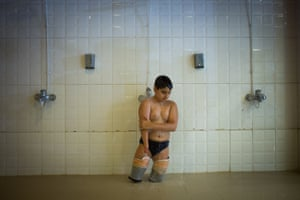 """Behnam Sahvi:  from the series """"Magic of Water"""", 2nd place Sport categoryEleven-year-old Pejman takes a shower before the Disabled Swimming Championships in Tehran province, Iran."""