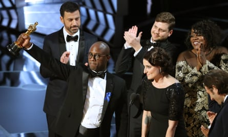 Moonlight director Barry Jenkins parades the best picture statuette.