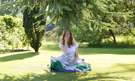A Beeja Meditation retreat guest tries nostril breathing. West Sussex, UK.
