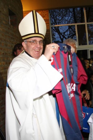 Pope Francis holding a San Lorenzo soccer jersey