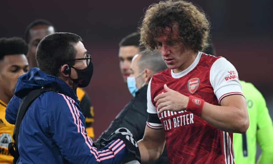 Arsenal's David Luiz is treated after Sunday's sickening clash of heads with Wolves' Raúl Jiménez