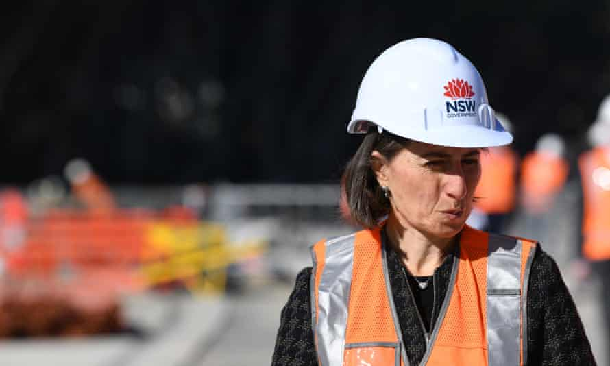 Gladys Berejiklian inspecting progress on the line in July. Since then delays and cost blowouts have plagued the project.