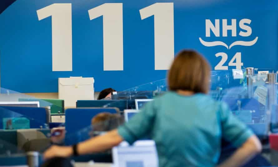 NHS staff deliver public information at an NHS 24 contact centre in Glasgow, Scotland.
