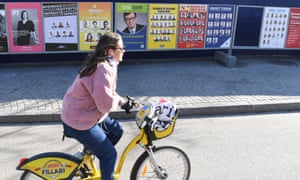 Campaign posters appear on the streets of Helsinki ahead of Finland's election.