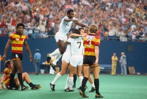 Pele celebrates with his Cosmos team-mates in a game at Giants Stadium in 1977.