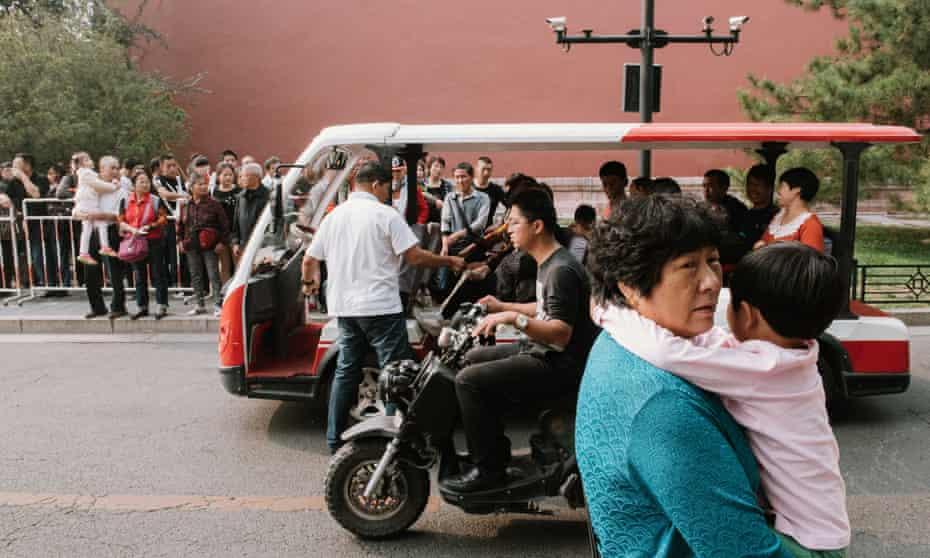 Beijing street scene with people and motor rickshaw