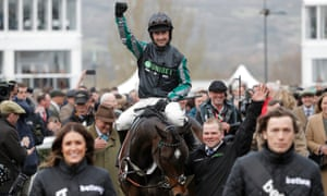 Nico de Boinville celebrates winning the 3 Queen Mother Champion Chase on Altior.