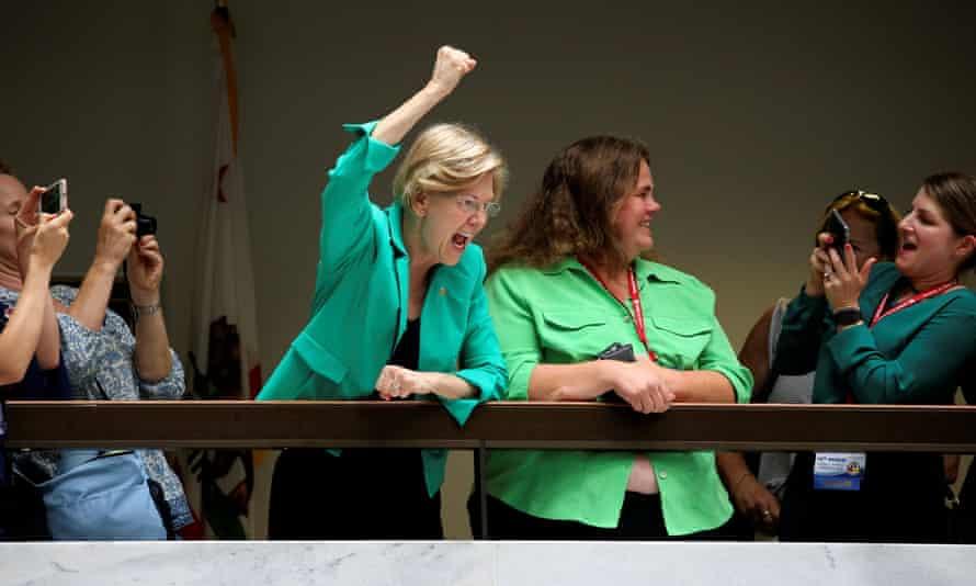 Senator Elizabeth Warren cheers on demonstrators.