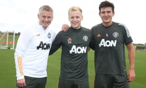 Ole Gunnar Solskjær and Harry Maguire greet Donny van der Beek at Manchester United's training ground
