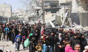 Civilians evacuate from the town of Jisreen in Eastern Ghouta.