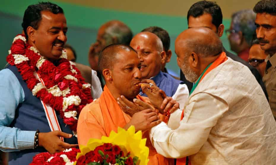 Yogi Adityanath is offered sweets after he was elected as chief minister of Uttar Pradesh.