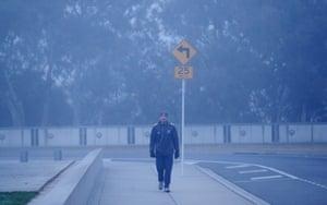 The Australian Conservatives senator Cory Bernardi walks to work through a thick fog in late June