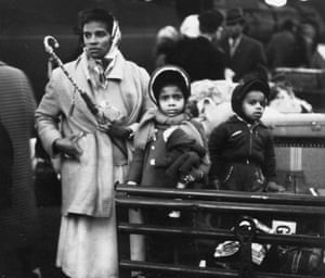 A family wait at a railway station after arrival