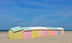 Row of  beach cabins in pastel colours