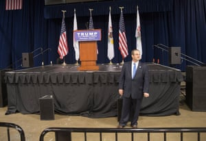 A campaign worker guards the podium