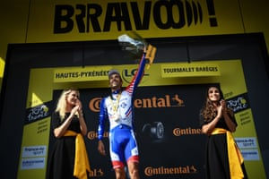 Thibaut Pinot looks as pleased as punch on the podium.