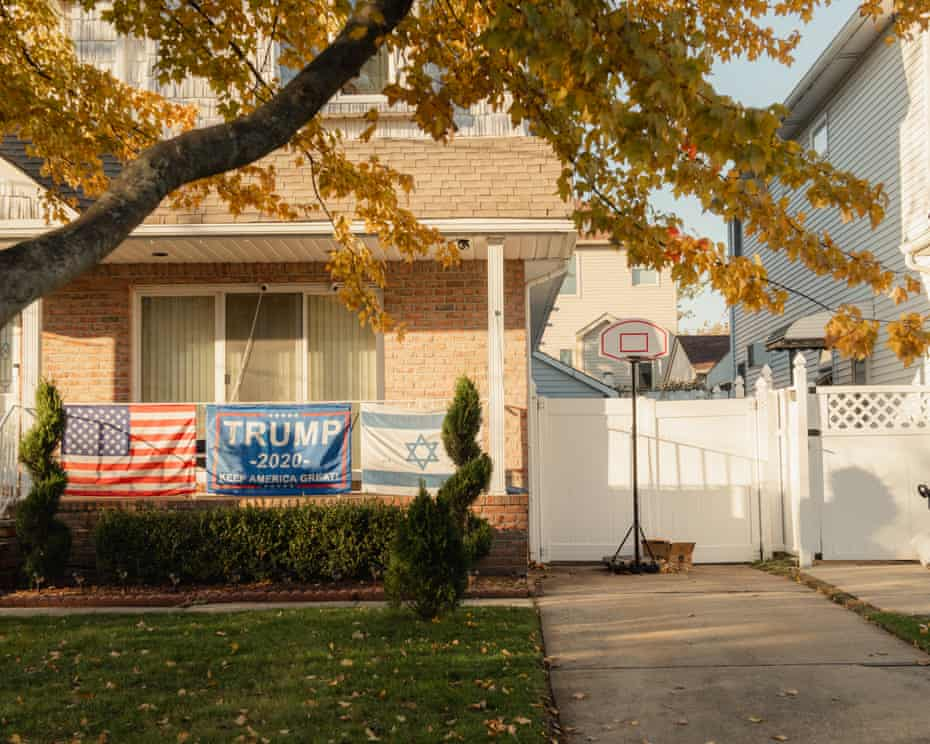 A Trump flag hangs on a home in Staten Island, which voted for Trump.