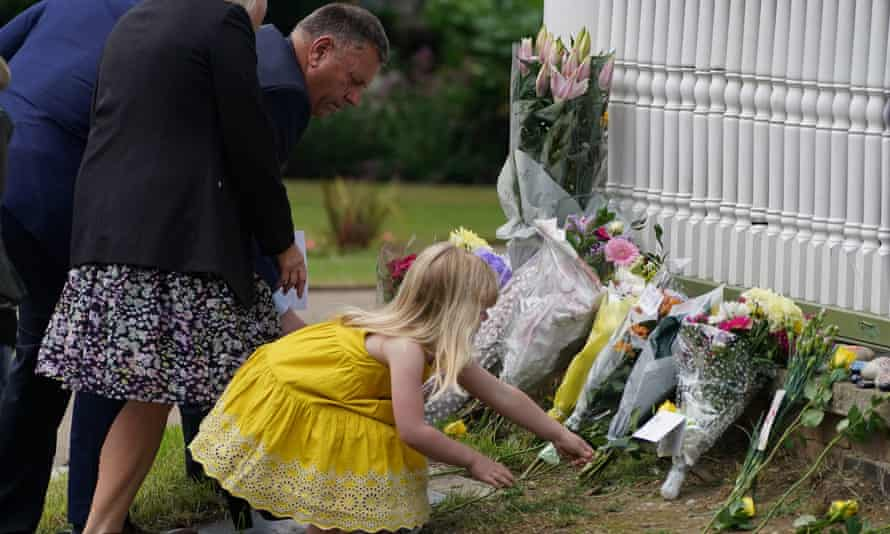 Mourners leaving flowers at the park's bandstand.