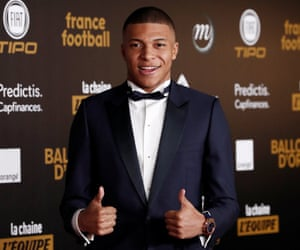 Kylian Mbappé, nominated for the main men's award and the best young player prize, arrives at the venue in Paris.