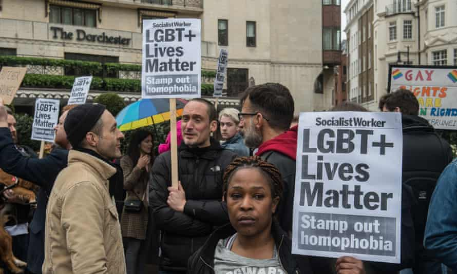 LGBT rights protesters outside the Dorchester hotel near Hyde Park, central London