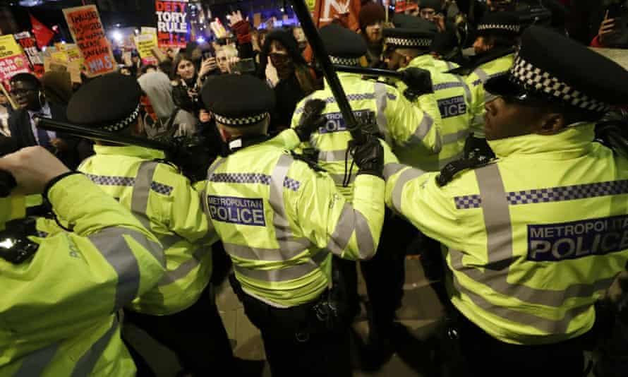 Police scuffle with anti-Boris Johnson marchers.