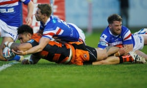 Jesse Sene-Lefao scores for Castleford in their narrow home victory against Wakefield, who fought back from being 28-8 midway through the second half.