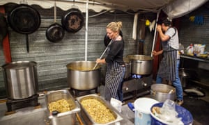 Volunteers with Refugee Community Kitchen preparing food for homeless migrants at Calais in 2016.