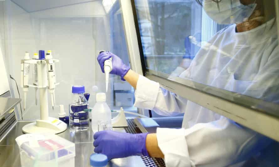 A laboratory technician carries out research for a vaccine against the coronavirus disease