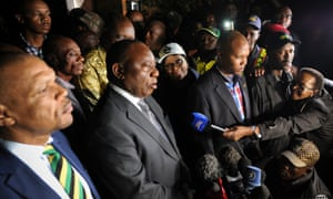 South African president Cyril Ramaphosa (centre) speaks outside Winnie Madikizela-Mandela's home in Soweto