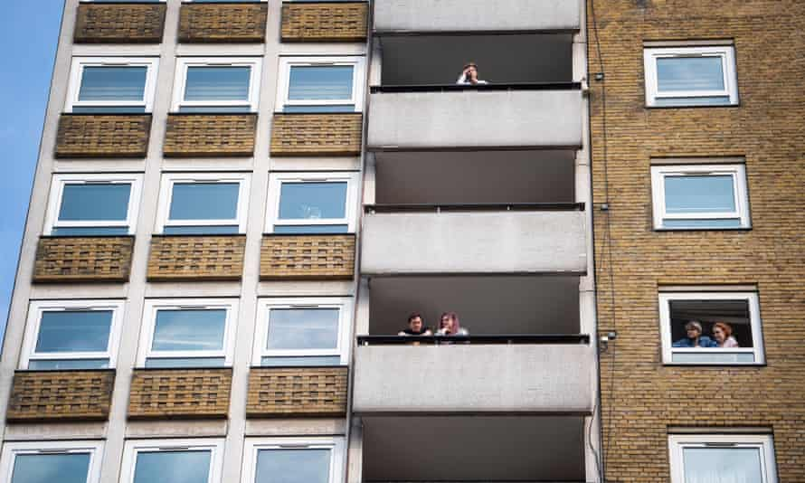 Questions of distance ... people look our their balconies in central London.