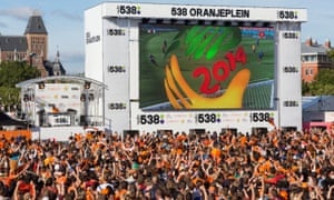 Fans in Amsterdam celebrate a Netherlands goal during a 2014 World Cup victory over Australia. There are no such scenes this summer.