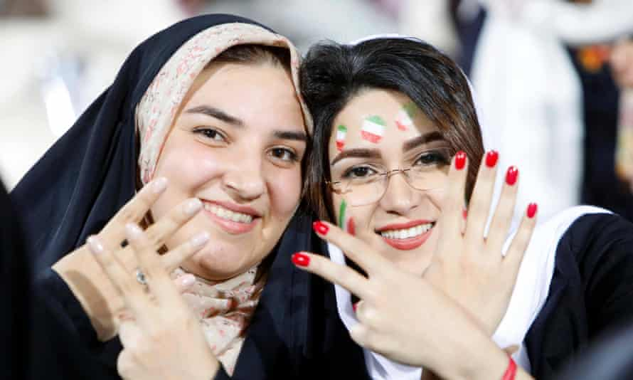 Iranian women pose at the Azadi stadium in Tehran as they attend the public viewing of the Fifa World Cup 2018 match between Iran and Spain in Kazan.