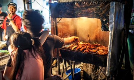 A barbecue stand on the streets of Chiang Mai, by night. Thailand