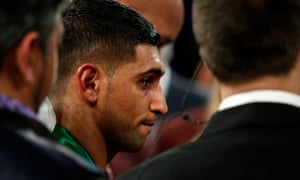 Amir Khan, back on his feet after having been knocked unconscious by a huge right hand from Saul 'Canelo' Álvarez in Las Vegas.