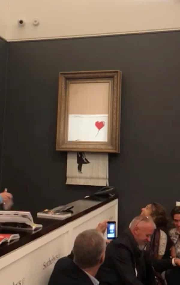 Banksy's Girl With Balloon is destroyed moments after being sold for more than £1m