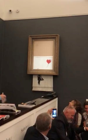 Girl With Balloon Banksy is destroyed moments after being sold for more than 1 million pounds