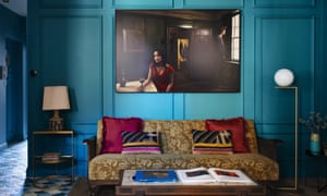 Unforgiven, one of Gillian Hyland's photographs, hangs above a vintage sofa; the floor lamp is by Michael Anastassiades.