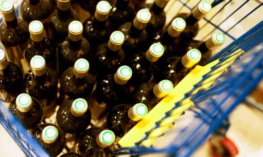 Tesco Vin Plus wine bottles in a shopping trolley in Calais France.