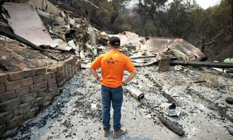 Gary Pratt inspects the ruins of his home at Spanish Flat Mobile Villa mobile home park near Lake Berryessa, California.