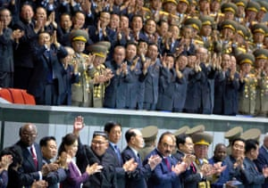 "North Korean leader Kim Jong Un, bottom left, waves as he attends the ""Glorious Country"" mass games."