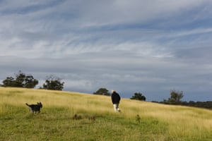 Bruce Pascoe with his dog Yambulla in the mandadyan nalluk grass on the hill above his property.