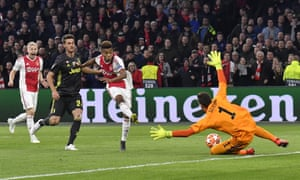 Ajax's David Neres, second right, slots the ball past Juventus goalkeeper Wojciech Szczesny, but it's ruled out for offside.