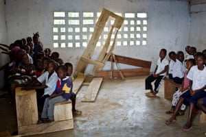 Liberia hopes that by bringing private companies into its education system it can end scenes like this at a Montserrado primary school where children are crammed on to classroom furniture.